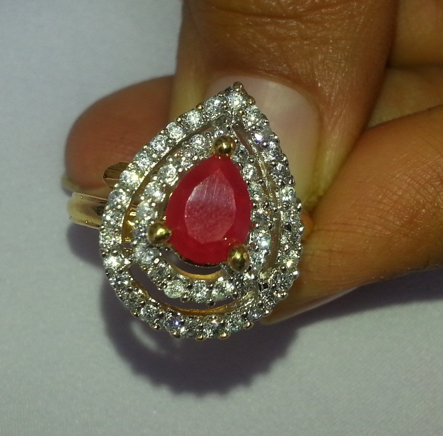 Gold Plated adjustable size ring with ruby magenta colour stone